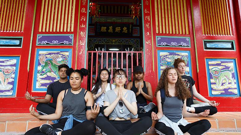 SJC students praying in Taiwan.