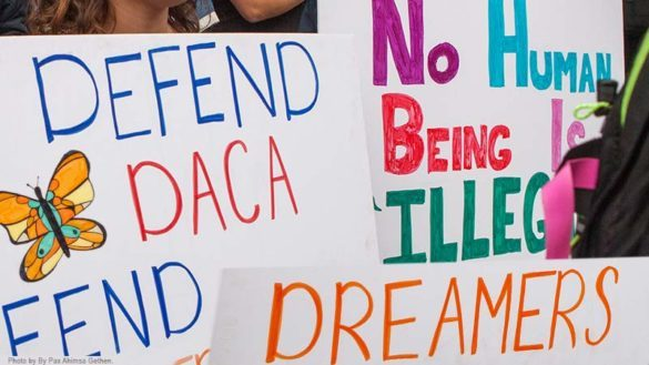 Poster boards that defend DACA.