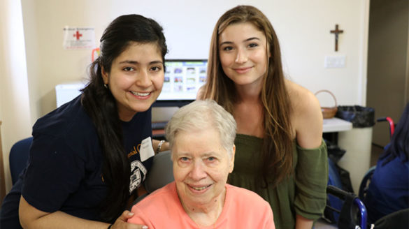Two female students pose for SJC's 2017 Day of Service at The Sister's of St. Joseph's motherhouse located in Brentwood Long Island.