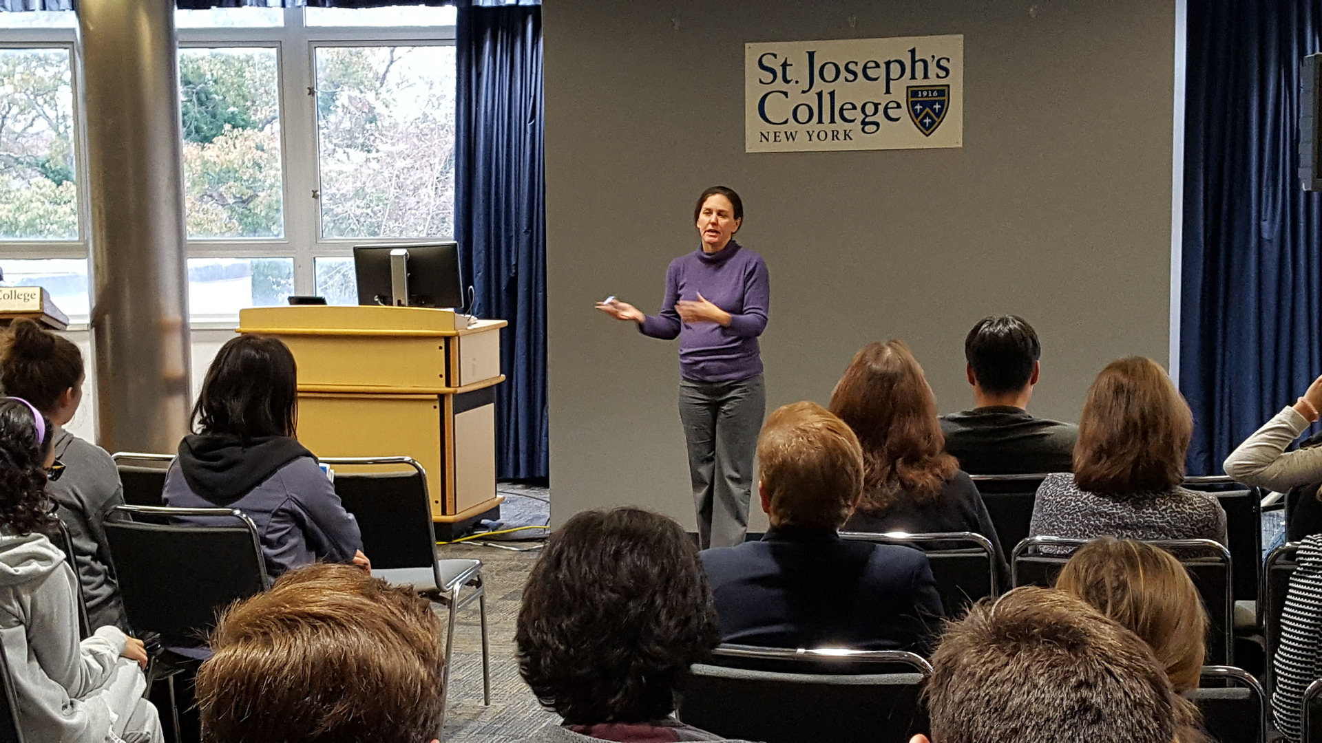 Deborah Horan speaking during a common hour event at SJC Long Island.
