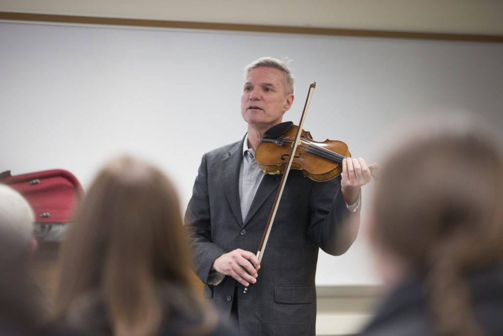 SJC President Boomgaarden playing the violin.