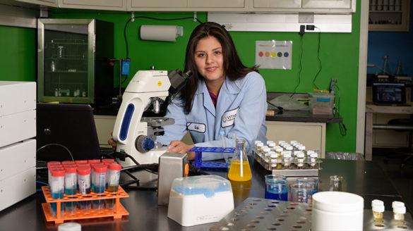 Female student working on a science project.