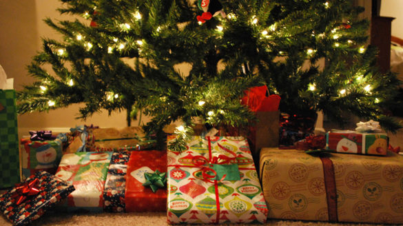Christmas presents under a Christmas tree.