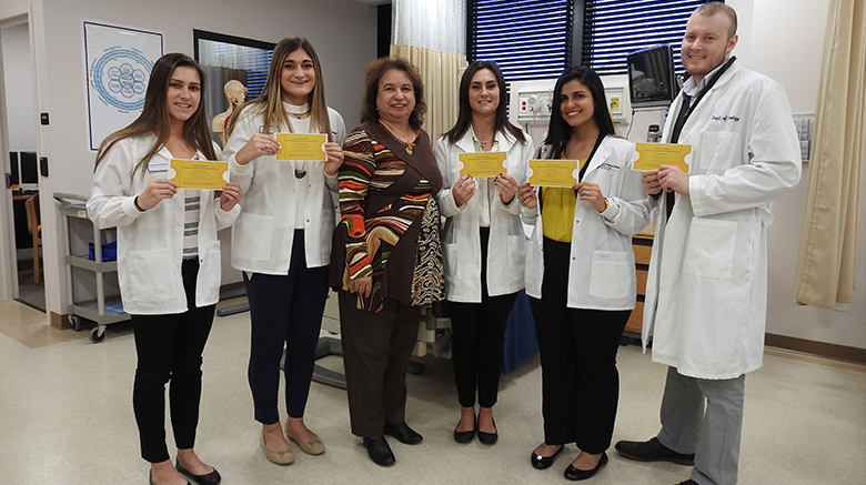 SJC Long Island nursing students with department chair Maria Fletcher, Ph.D.