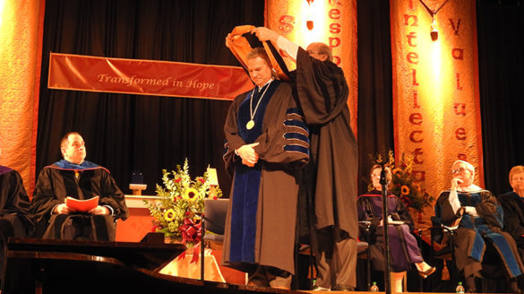 President is hooded at ceremony.