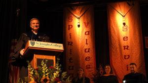 President of college at podium.