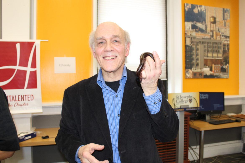 Louis Sorkin holding a millipede.