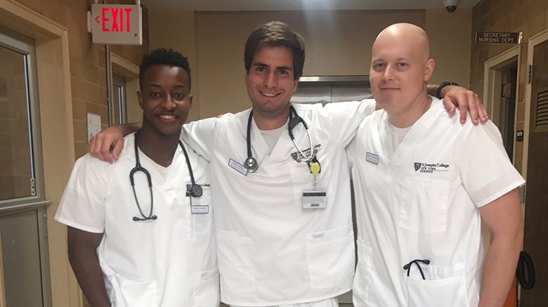 Frank with two SJC Long Island nursing students.