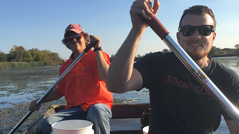 Frank with friend on a canoe during BIO 279.