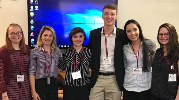 Seven SJC students at the New Critics Conference.