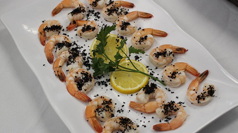 Shrimp coated in black ants.