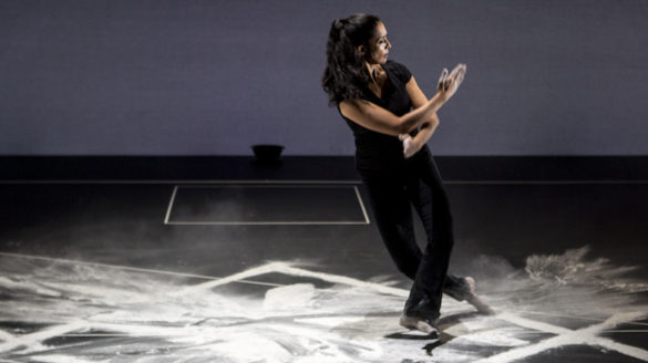 Woman dancing on chalk on stage.