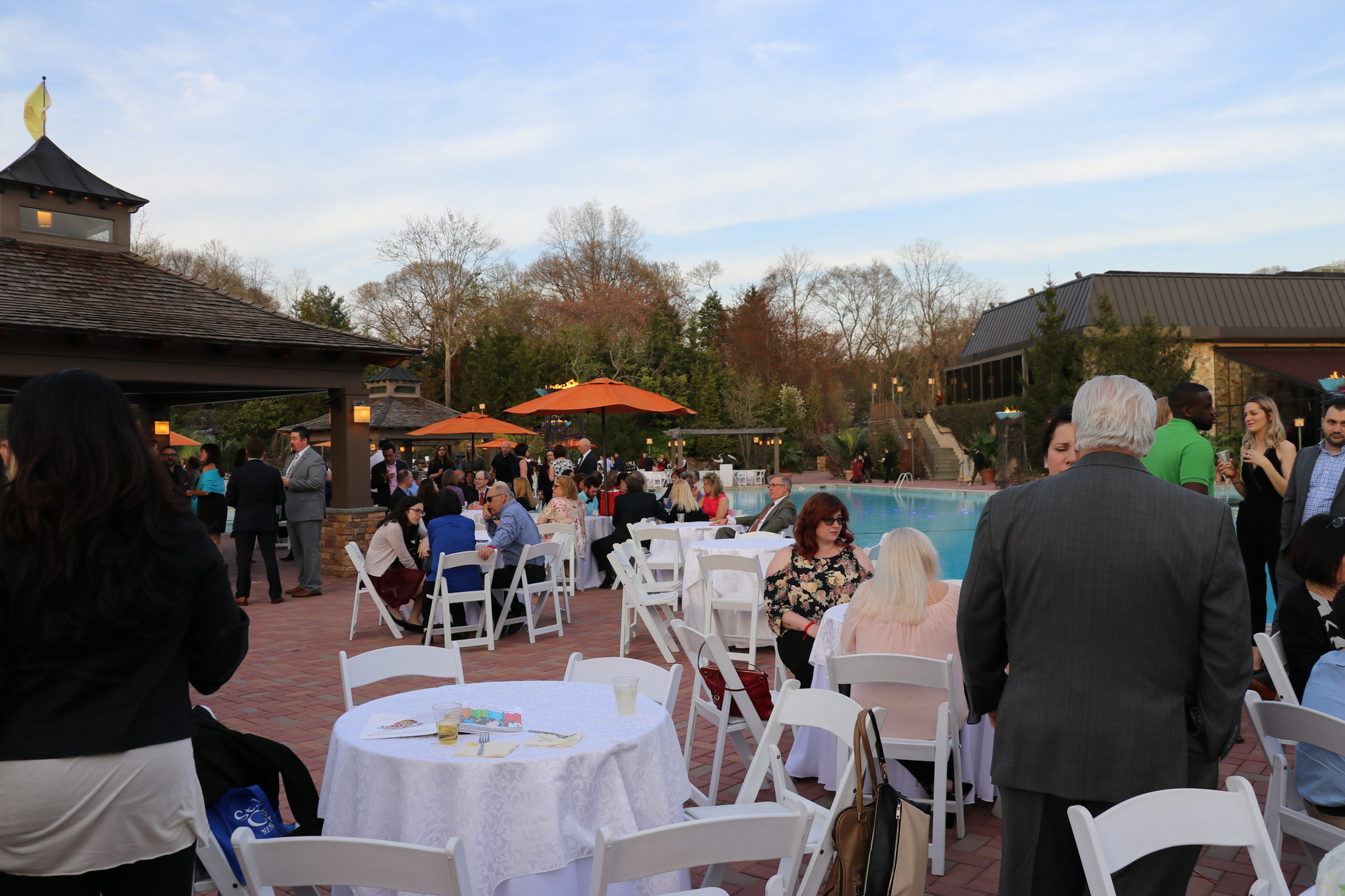 People mingling during the event at Crest Hollow Country Club.