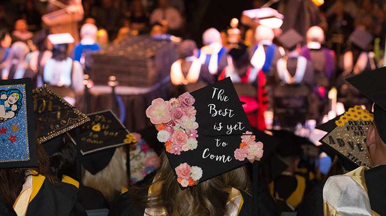 Decorated caps from SJC Long Island's 2017 commencement.