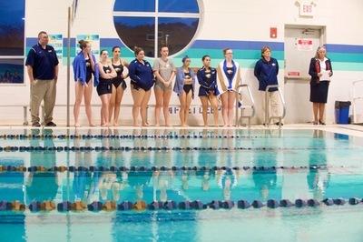 SJC Long Island's swim team with Coach Bardenberger.