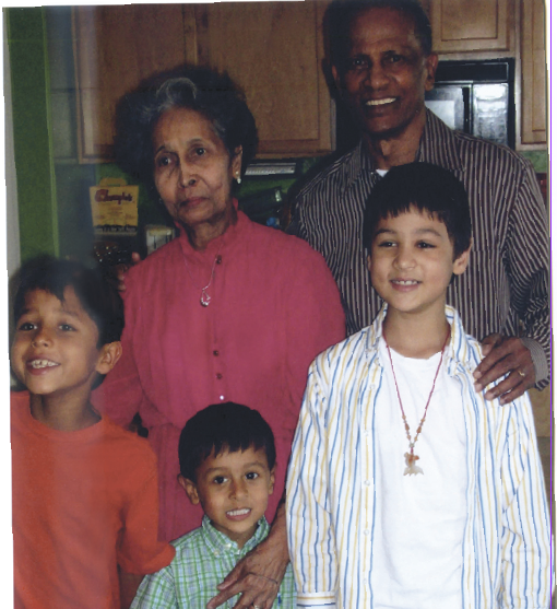 Mr. and Mrs. Outar with their grandsons.