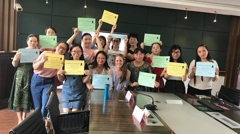 Alyssa Patterson with the Chinese English teachers at the end of the program.