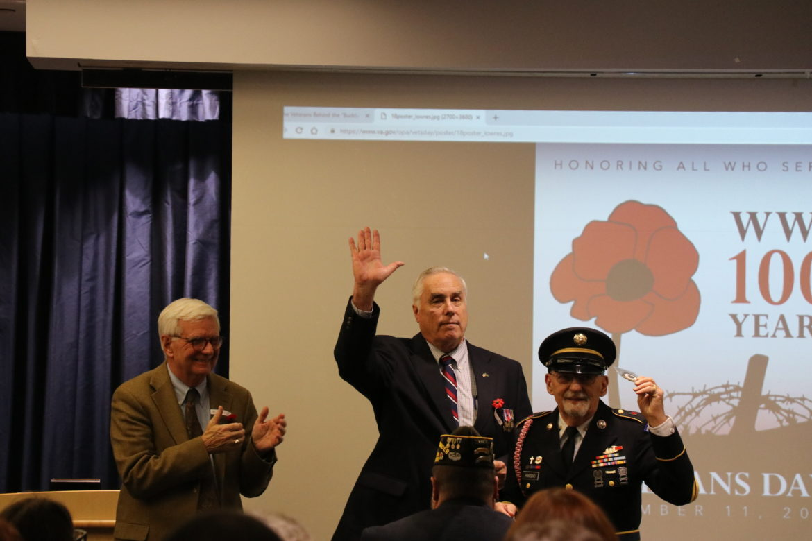 Local veteran receiving Challenge Coin from Dr. Travis and Dr. Vitters.