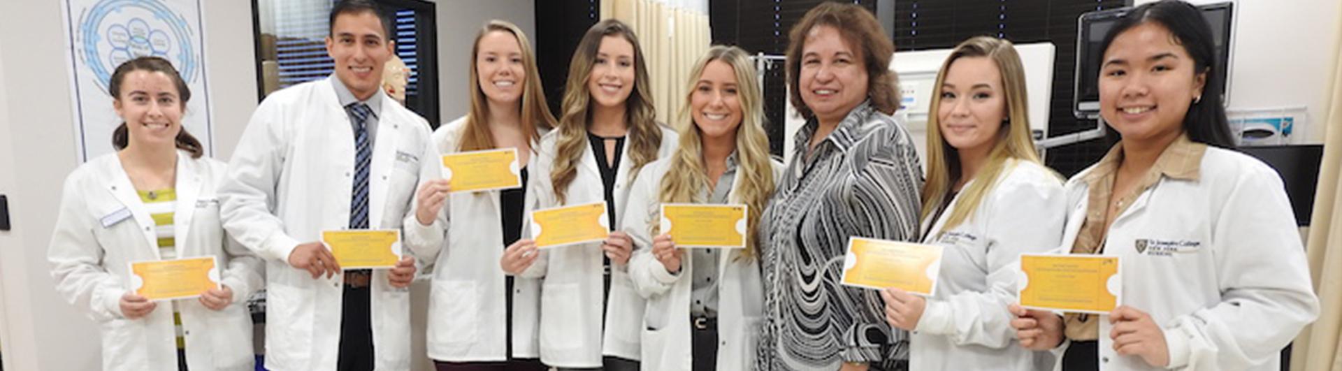 SJC Long Island students holding their golden ticket to Northwell Health's prestigious event.