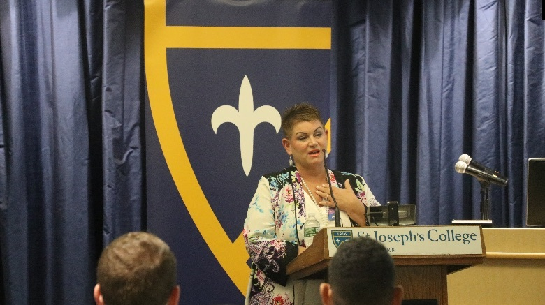 Woman speaking at podium.