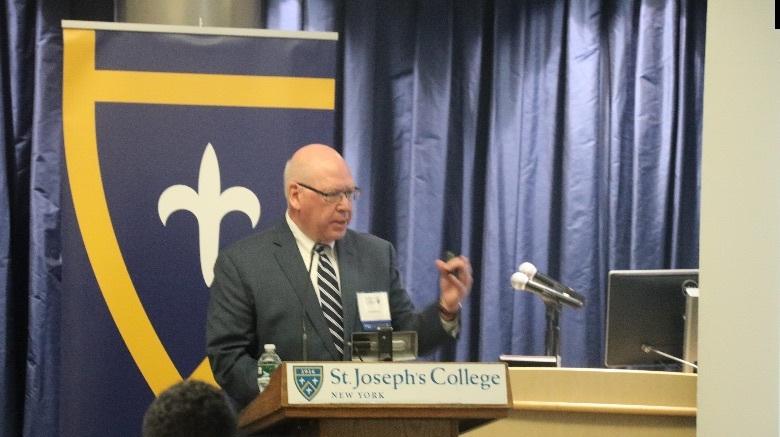 Man speaking at a podium.