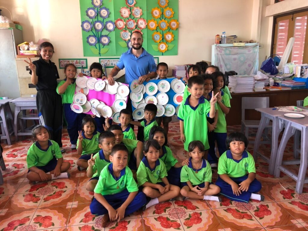 John Davis with his students in Cambodia.