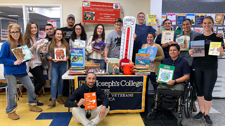 SVA with the books for Cambodia.