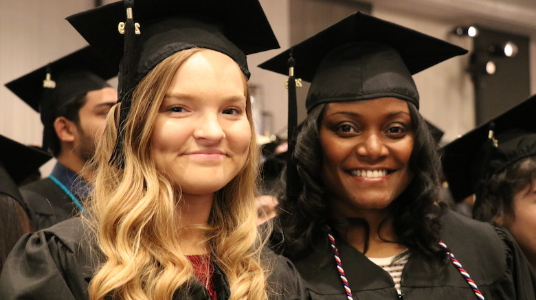 Students turn their tassels at SJC Brooklyn's commencement.
