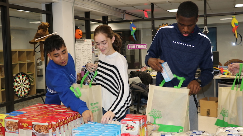 Students at SJC Brooklyn donate and pack Thanksgiving meals for those in need in the local community.