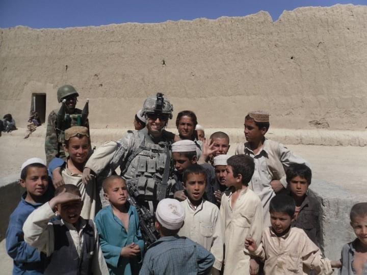 Davis with children in Afghanistan.