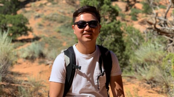 Student in desert with sunglasses.